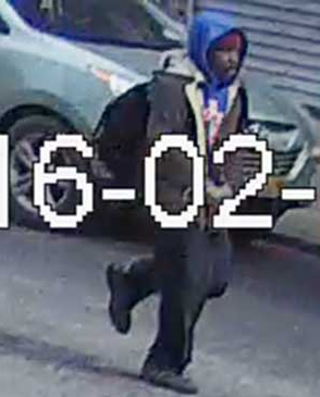 The perpetrator is seen fleeing the scene, in a screencap from security camera footage. (crownheights.info)