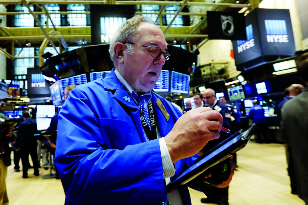 Trader Eugene Mauro works on the floor of the New York Stock Exchange, Tuesday, Jan. 26, 2016. Higher oil prices and some positive earnings news from U.S. companies are helping to send the stock market higher. (AP Photo/Richard Drew)