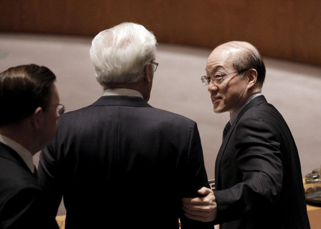 Chinese ambassador Liu Jieyi greets Russian ambassador Vitaly Churkin before the United Nations Security Council votes to approve a resolution that would dramatically tighten existing restrictions on North Korea at the United Nations Headquarters in New York March 2, 2016. REUTERS/Brendan McDermid