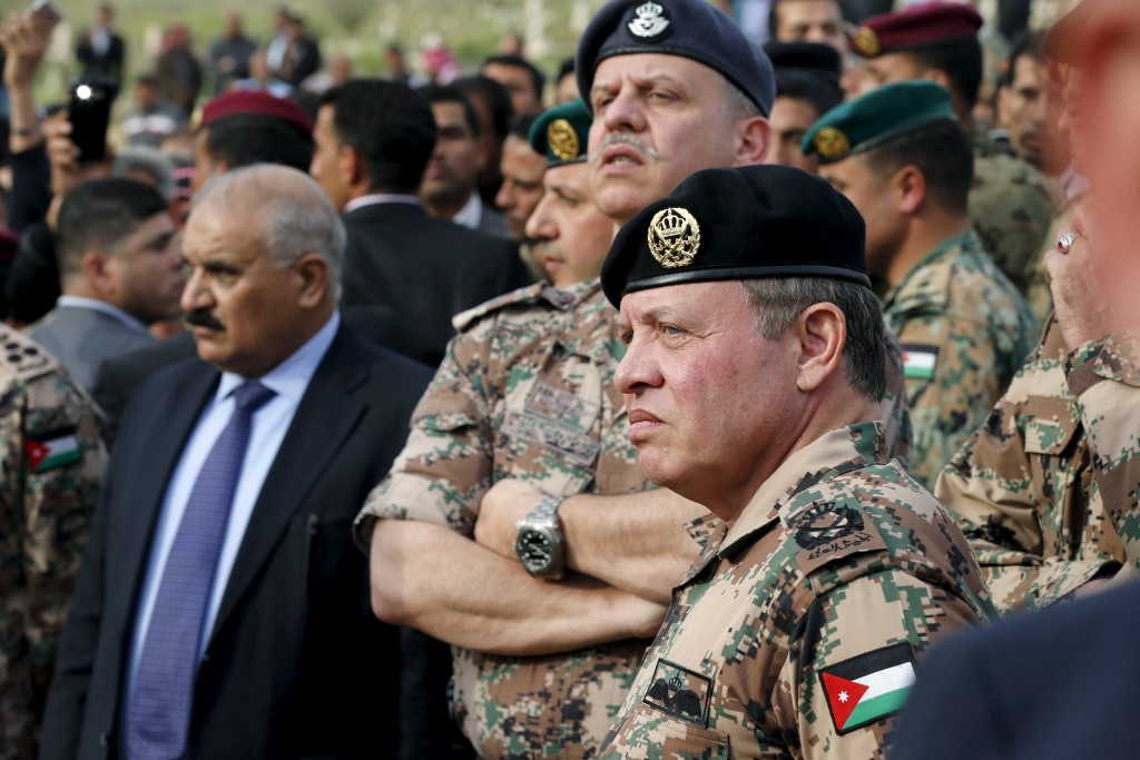 Jordan's King Abdullah and his brother Prince Faisal attend the funeral of Captain Rashed Zyoud, who was killed during a raid conducted in Irbid by Jordanian security forces on Islamic State militants, in Zarqa, Jordan, March 2, 2016. (Muhammad Hamed/Reuters)