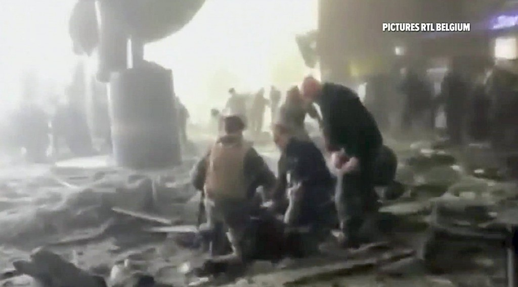 Rescue workers treat victims at the Brussels airport, in this screencap taken from TV video. (Reuters/RTL Belgium via Reuters TV)