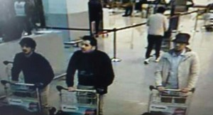 Three of the suspected terrorists at the Brussels airport. The two on the left are believed to be dead; they each wear one black glove, presumably to hide the suicide-bomb detonator. The man on the right is believed to be alive and on the run.