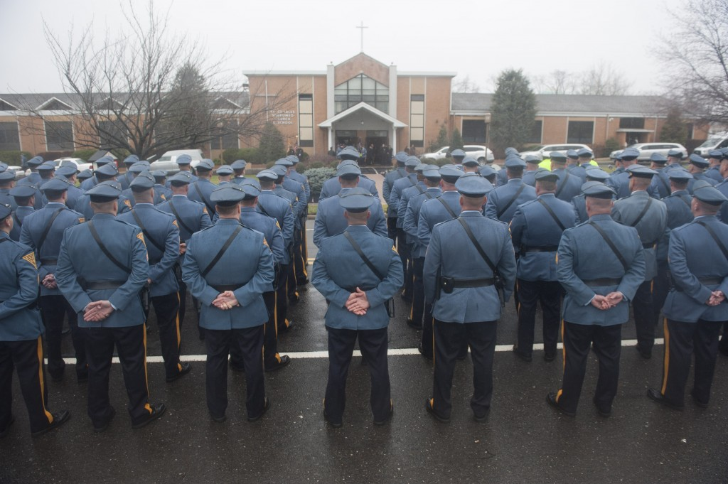 New Jersey State Troopers stand at attention at the funeral of Trooper Sean Cullen  in Cinnaminson, N.J., on Monday. (John Ziomek/Camden Courier-Post via AP)