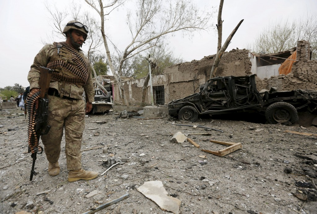 An Afghan policeman inspects the site of a blast near the Indian consulate in Jalalabad, Afghanistan March 2, 2016. REUTERS/Parwiz