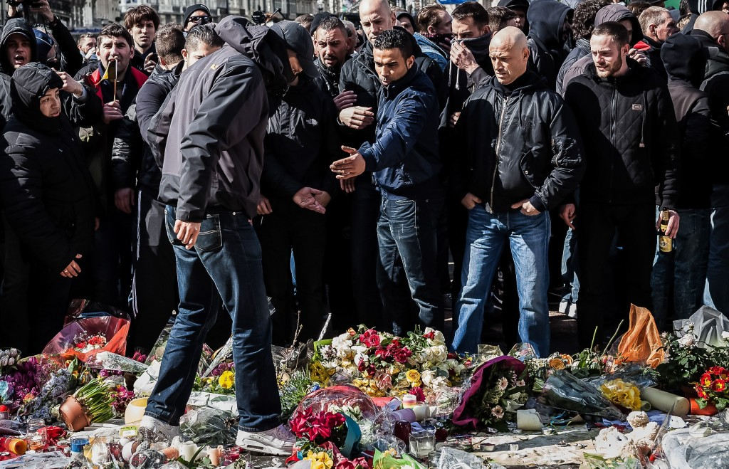 Right-wing demonstrators protest at a memorial site at the Place de la Bourse in Brussels on Sunday. (AP Photo/Valentin Bianchi)