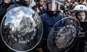 Riot police at a protest at the Place de la Bourse in Brussels on Sunday. (AP Photo/Valentin Bianchi)