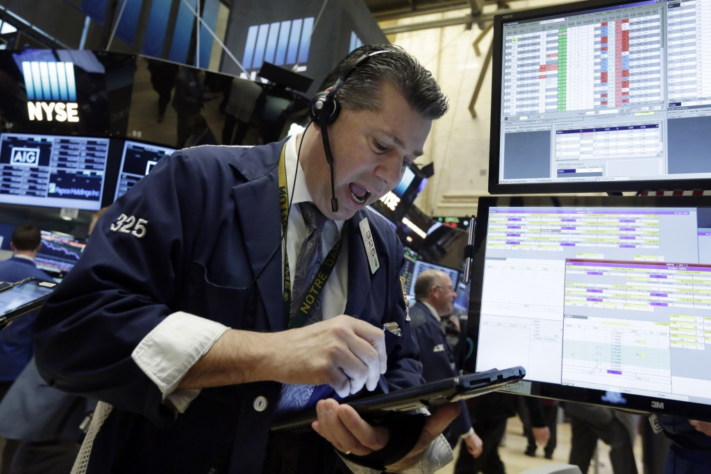 Trader William McInerney works on the floor of the New York Stock Exchange on Tuesday. (AP Photo/Richard Drew)