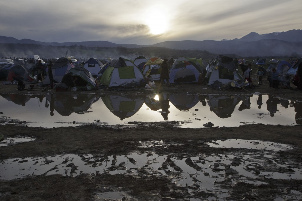 Migrants living in tents at a flooded field at the northern Greek border station of Idomeni, Tuesday, March 8, 2016. Up to 14,000 people are stranded on the outskirts of the village of Idomeni, with more than 36,000 in total across Greece, as EU leaders who held a summit with Turkey on Monday said they hoped they had reached the outlines of a possible deal with Ankara to return thousands of migrants to Turkey. (AP Photo/Visar Kryeziu)