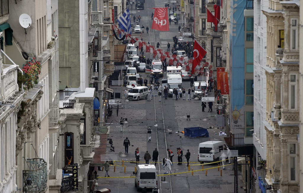 Emergency services at the scene of an explosion, on a street, in Istanbul, Turkey, Saturday, March 19, 2016. An explosion on Istanbul's main pedestrian shopping street on Saturday has killed a number of people and injured over a dozen others. (AP Photo/Emrah Gurel)