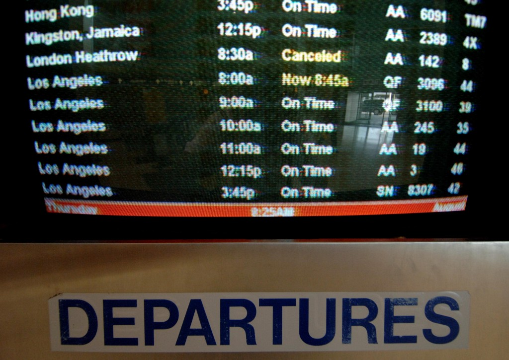 The departures board at the American Airlines terminal of JFK Airport. (AP Photo/Henny Ray Abrams)