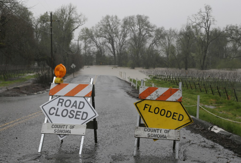 A road in Forestville, Calif., remains closed to flooding on Friday. (AP Photo/Eric Risberg)