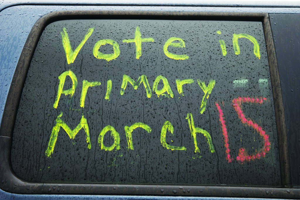 A message encouraging people to vote is written on a window ahead of a campaign visit by Democratic presidential candidate Sen. Bernie Sanders (I-Vt.), Sunday, March 13, 2016, at Ohio State University in Columbus, Ohio. (AP Photo/Matt Rourke)