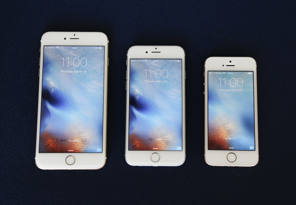 From left, the iPhone 6S Plus, 6S and SE lie next to each other in a comparison photograph. (AP Photo/Julie Jacobson)