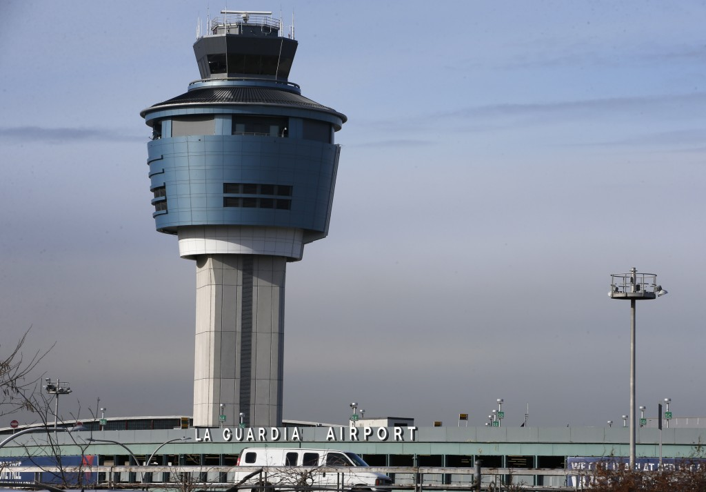 An air traffic control tower rises above a ramp serving LaGuardia Airport in New York. (AP Photo/Kathy Willens)