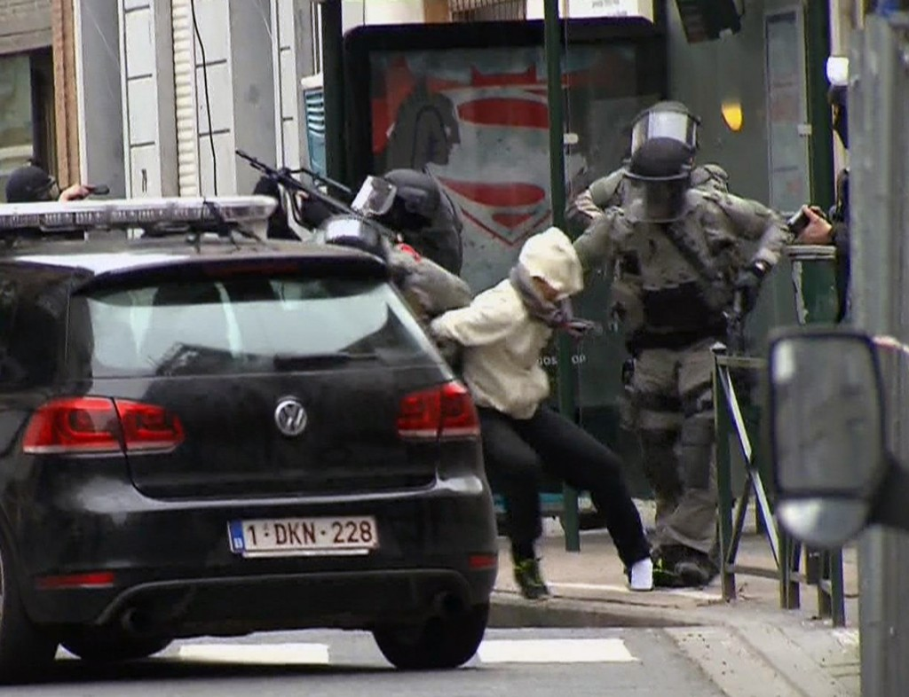 In this screencap taken from VTM, Salah Abdeslam is arrested by police on March 18. (VTM via AP)
