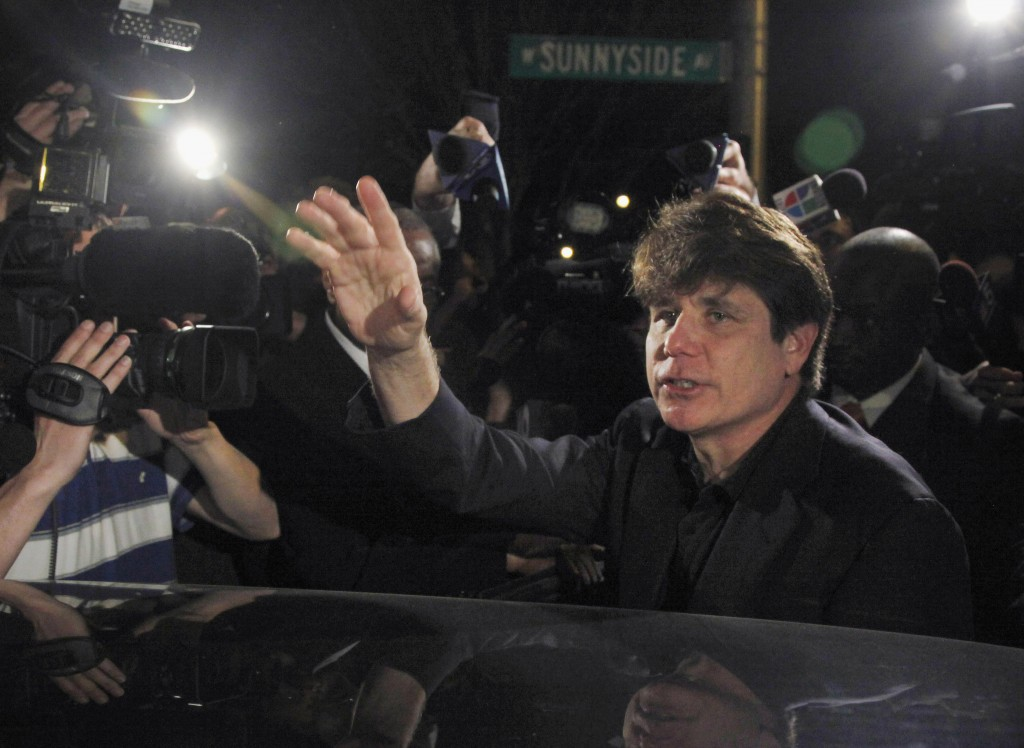 In this March 15, 2012 photo, former Illinois Gov. Rod Blagojevich departs his Chicago home for Littleton, Colo., to begin his 14-year prison sentence on corruption charges. (AP Photo/Charles Rex Arbogast, File)