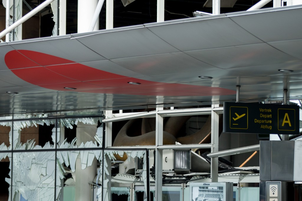 Blown-out windows are visible at Brussels Airport on Friday. (AP Photo/Andrew Harnik, Pool)