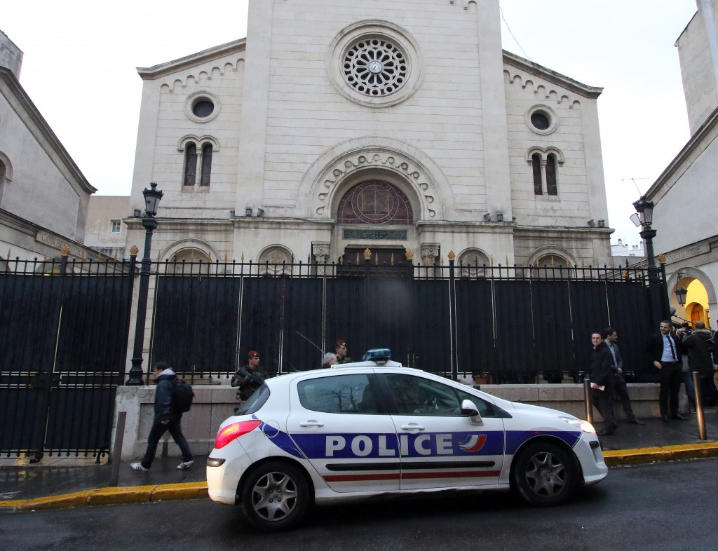 A police car in front of a synagogue in Marseilles, France, during a visit by Interior Minister Bernard Cazeneuve on Jan. 14. (AP Photo/Claude Paris)