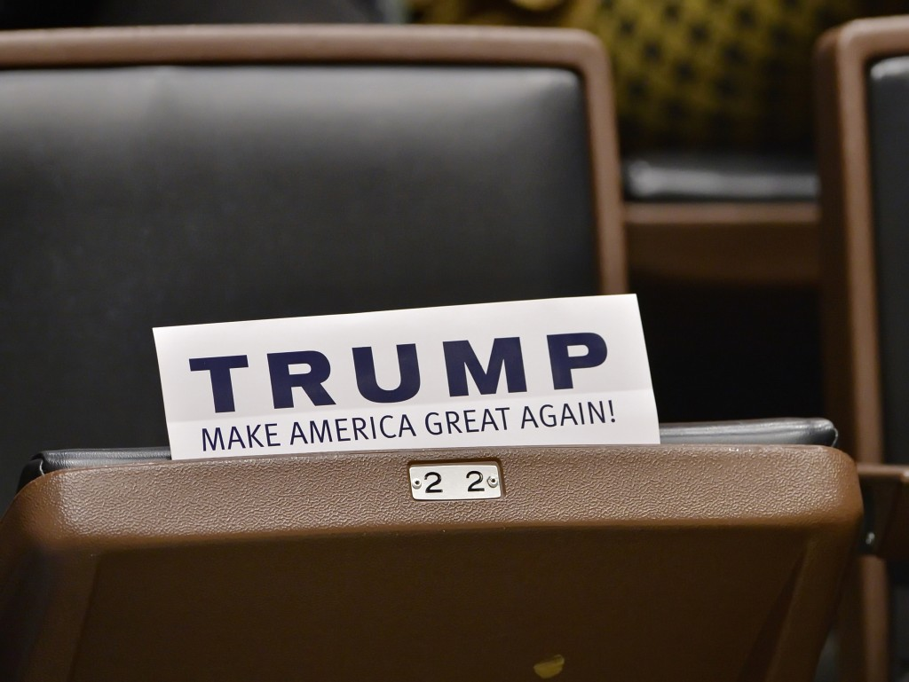 A Trump sign is seen on a seat as Republican presidential candidate Donald Trump speaks during a town hall meeting. (AP Photo/Richard Shiro)
