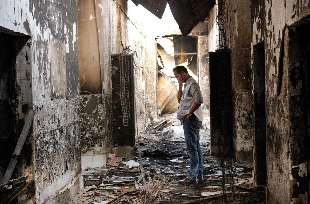 In this Oct. 16, 2015 photo, an employee of Doctors Without Borders walks inside the charred remains of the organization's hospital after it was hit by a U.S. airstrike in Kunduz, Afghanistan. (AP Photo/Najim Rahim, File)