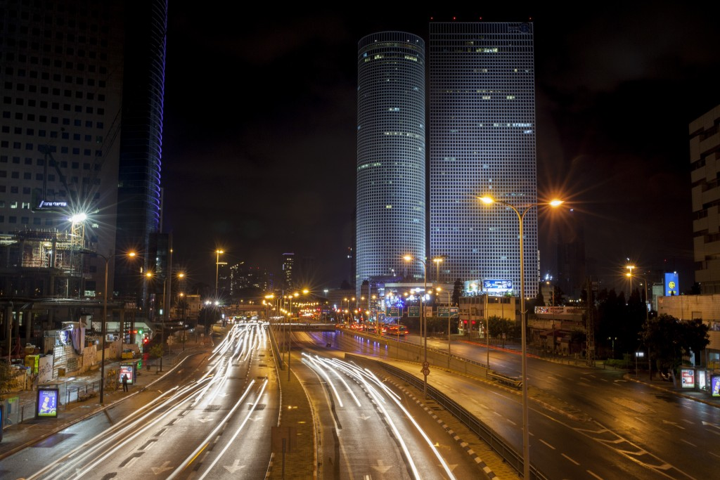 The Azrieli buildings, as seen over the Ayalon Highway and river at night in Tel Aviv. (Esther Rubyan/Flash 90)
