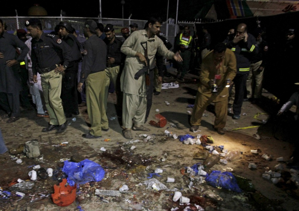 Security officials gather at the site of the blast in Lahore, Pakistan, on Sunday. (Reuters/Mohsin Raza)