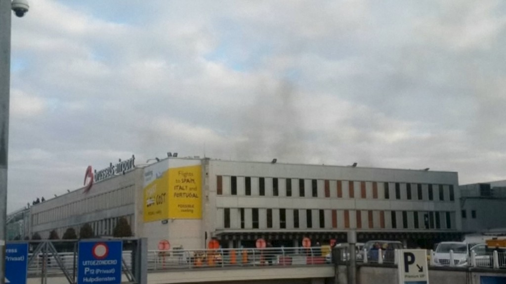 Black smoke is seen rising from the Brussels airport following explosions, in this still image made available March 22, 2016. REUTERS/Peter van Rossum via Reuters TV ATTENTION EDITORS - THIS PICTURE WAS PROVIDED BY A THIRD PARTY. REUTERS IS UNABLE TO INDEPENDENTLY VERIFY THE AUTHENTICITY, CONTENT, LOCATION OR DATE OF THIS IMAGE. EDITORIAL USE ONLY. NOT FOR SALE FOR MARKETING OR ADVERTISING CAMPAIGNS. NO RESALES. NO ARCHIVE. THIS PICTURE IS DISTRIBUTED EXACTLY AS RECEIVED BY REUTERS, AS A SERVICE TO CLIENTS. BELGIUM OUT. NO COMMERCIAL OR EDITORIAL SALES IN BELGIUM TPX IMAGES OF THE DAY