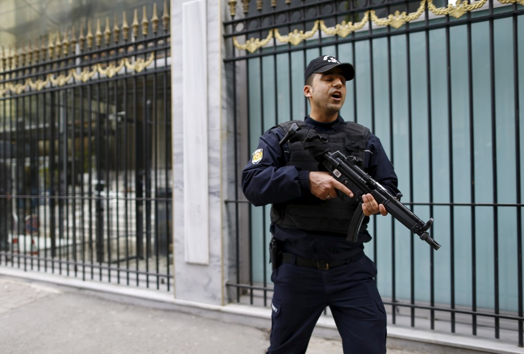 A Turkish riot police stands guard in front of the Belgian Consulate in central Istanbul, Turkey March 22, 2016. REUTERS/Osman Orsal