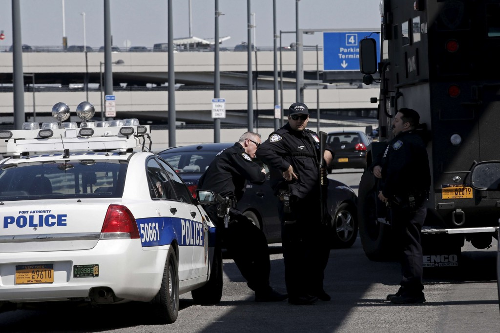Port Authority Police officers stand guard outside a terminal at John F. Kennedy International Airport in New York on March 22, 2016. Atlanta's airport was briefly evacuated on Wednesday over a suspicious package while U.S. law enforcement agencies and travelers were on edge a day after deadly suicide bombings by Islamist militants rocked Brussels. REUTERS/Mike Segar/Files