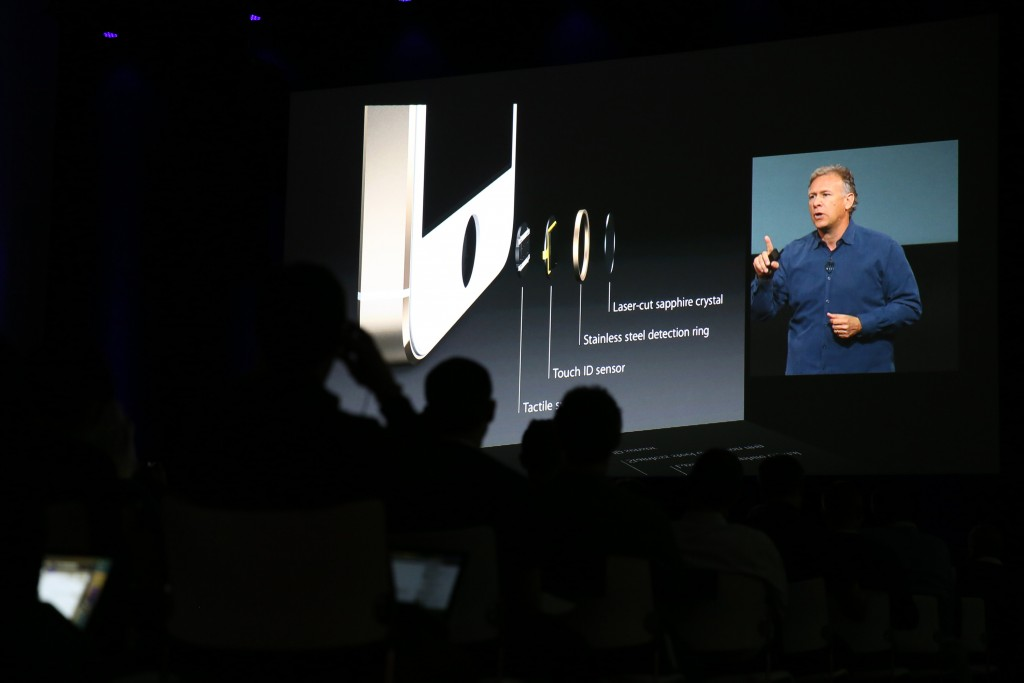 Phil Schiller, Apple's senior vice president of worldwide marketing, speaks about iPhone security features at a product announcement in 2013. (Kay Nietfeld/DPA/Zuma Press/TNS)