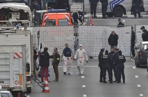 Forensic staff leave metro station Maelbeek in Brussels. (AP Photo/Martin Meissner)