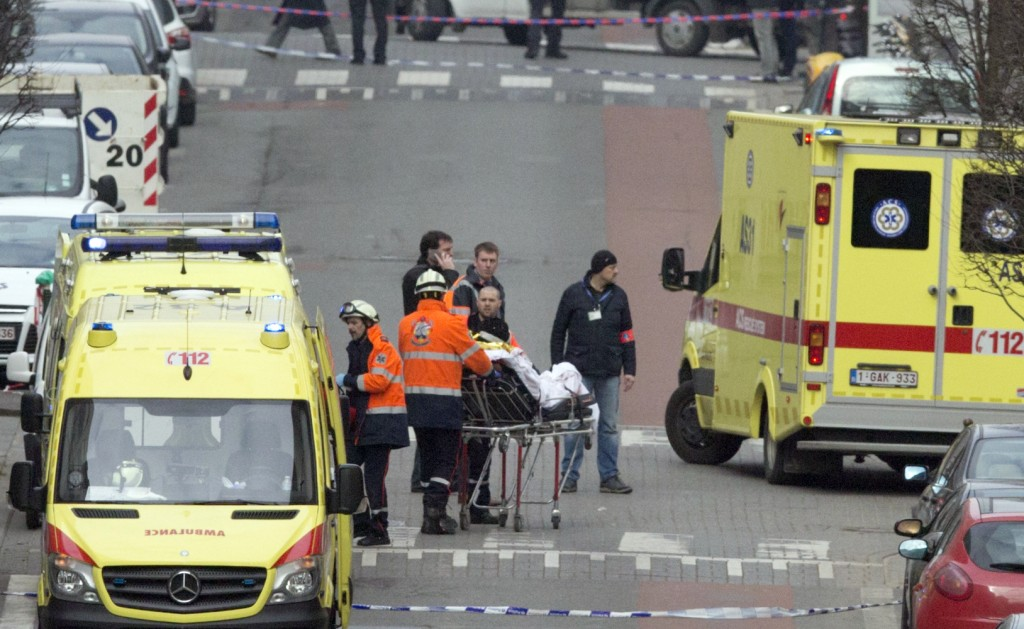 Emergency services evacuate a victim by stretcher after a explosion in a main metro station in Brussels on Tuesday, March 22, 2016. Explosions rocked the Brussels airport and the subway system Tuesday, killing at least 13 people and injuring many others just days after the main suspect in the November Paris attacks was arrested in the city, police said. (AP Photo/Virginia Mayo)
