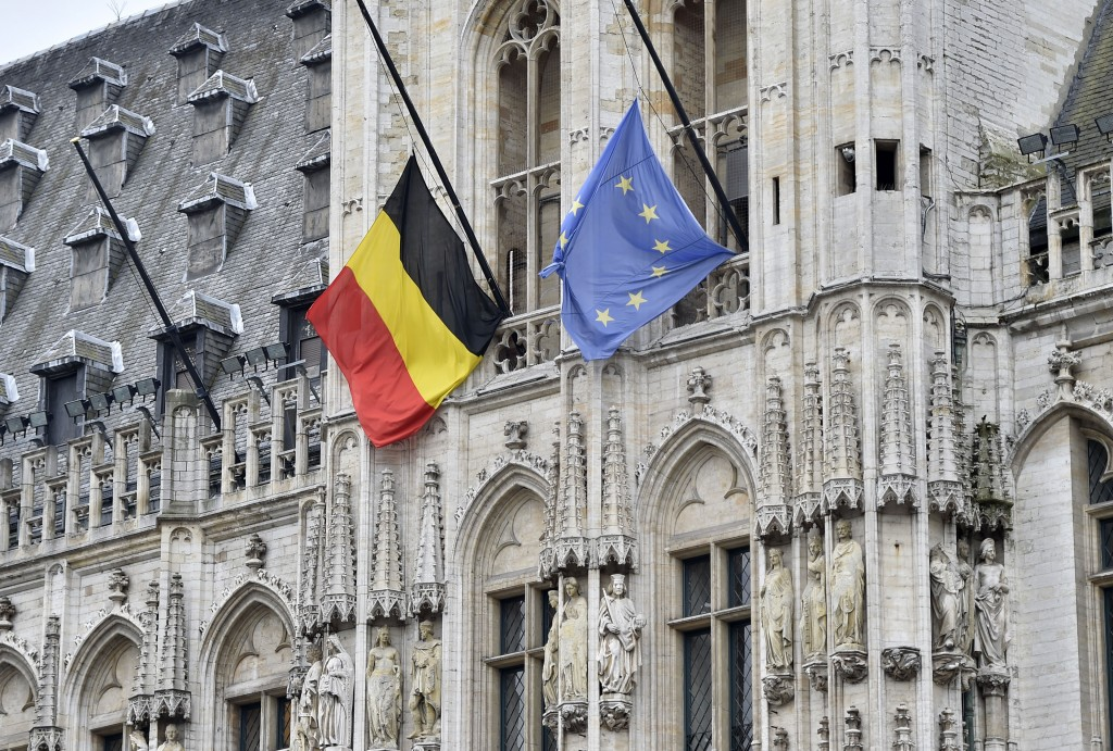 A Belgian and a European flag hanging half staff at the Grand Place in the center of Brussels, Wednesday, March 23, 2016. Bombs exploded yesterday at the Brussels airport and one of the city's metro stations Tuesday, killing and wounding scores of people, as a European capital was again locked down amid heightened security threats. (AP Photo/Martin Meissner)