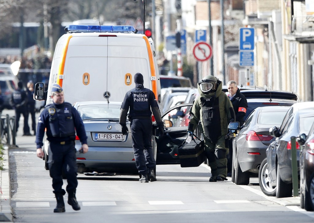 Security and emergency-services officials in Schaerbeek, Belgium, on Friday. (AP Photo/Alastair Grant)