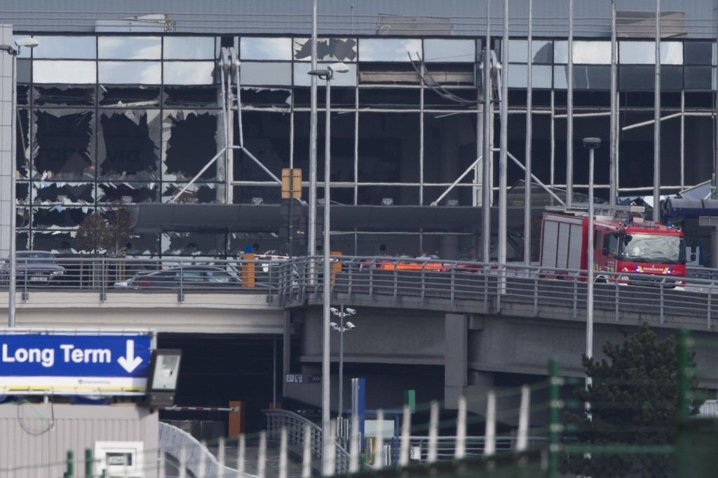 The blown out facade of the terminal at Zaventem airport. (AP Photo/Peter Dejong)