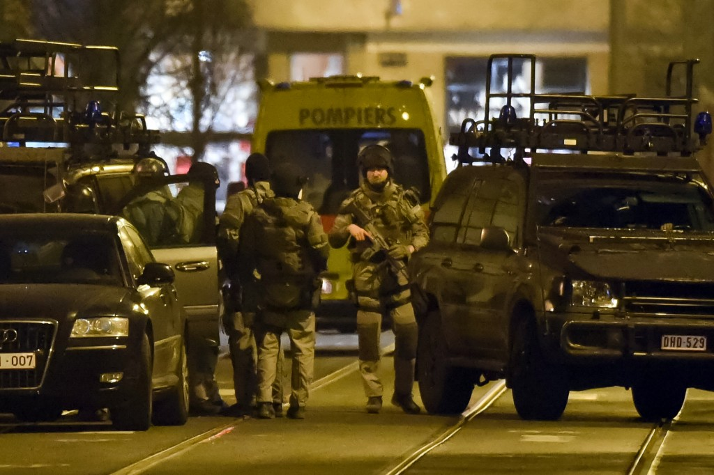 Special operations police take positions during the raid in Brussels on Tuesday. (AP Photo/Geert Vanden Wijngaert)