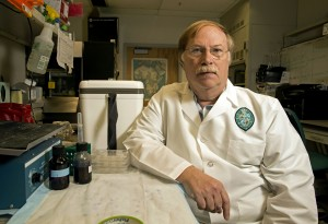 In this Thursday, March 3, 2016 photo, Tulane microbiology professor Bob Garry poses for a photo in the laboratory of the J. Bennett Johnston Health & Environmental Research Building in New Orleans. (AP Photo/Max Becherer)