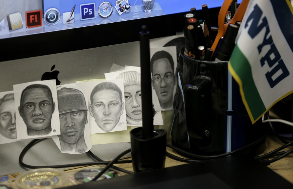 Sketches taped to the computer monitor of Matthew Klein. (AP Photo/Seth Wenig)