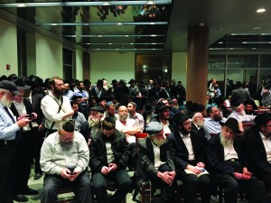 Members of the Crown Heights Jewish community at a press conference Thursday evening at the Jewish Children's Museum called by the NYPD on the arrest of the man who stabbed Leiby Brikman and to update the community on how they will better protect them. (Isser Berg/Hamodia Photo)