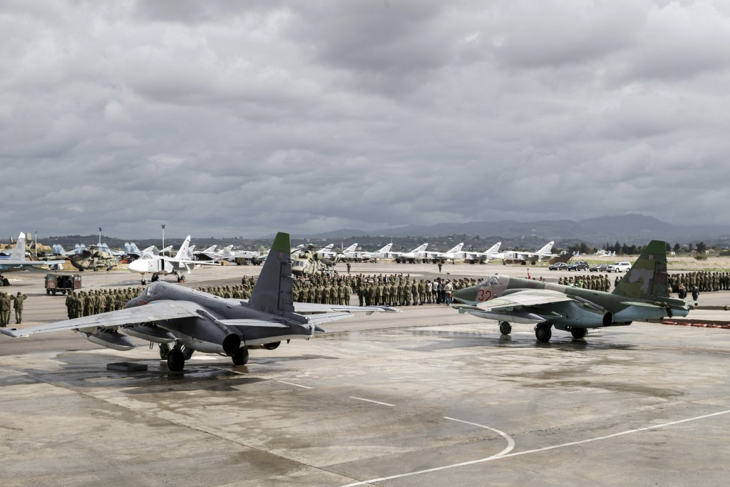 Russian and Syrian servicemen line up near military jets during a ceremony dedicated to the withdrawal of Russian troops from Syria at Hmeymim airbase, Syria, March 15, 2016. REUTERS/Russian Ministry of Defence/Vadim Grishankin/Handout via Reuters ATTENTION EDITORS - THIS IMAGE WAS PROVIDED BY A THIRD PARTY. REUTERS IS UNABLE TO INDEPENDENTLY VERIFY THE AUTHENTICITY, CONTENT, LOCATION OR DATE OF THIS IMAGE. FOR EDITORIAL USE ONLY. NOT FOR SALE FOR MARKETING OR ADVERTISING CAMPAIGNS. FOR EDITORIAL USE ONLY. NO RESALES. NO ARCHIVE. THE PICTURE IS DISTRIBUTED EXACTLY AS RECEIVED BY REUTERS, AS A SERVICE TO CLIENTS.