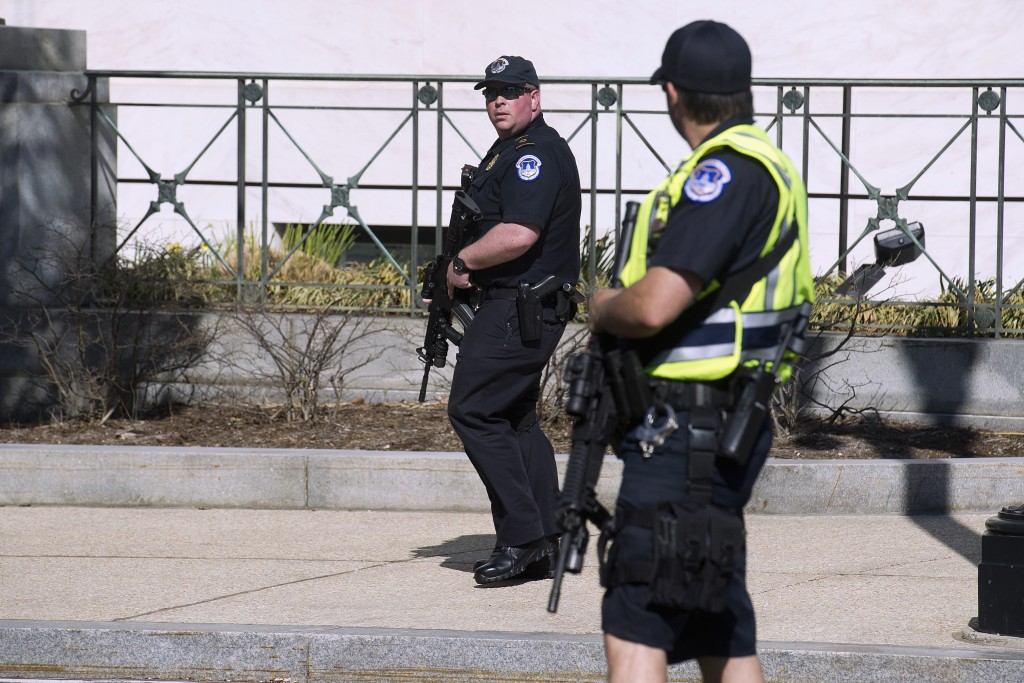 Police stand guard outside the Capitol in Washington, Monday, March 28, 2016. Capitol Police officers say a man was shot by police after drawing a weapon at a U.S. Capitol checkpoint. He was taken to the hospital. (AP Photo/Cliff Owen)