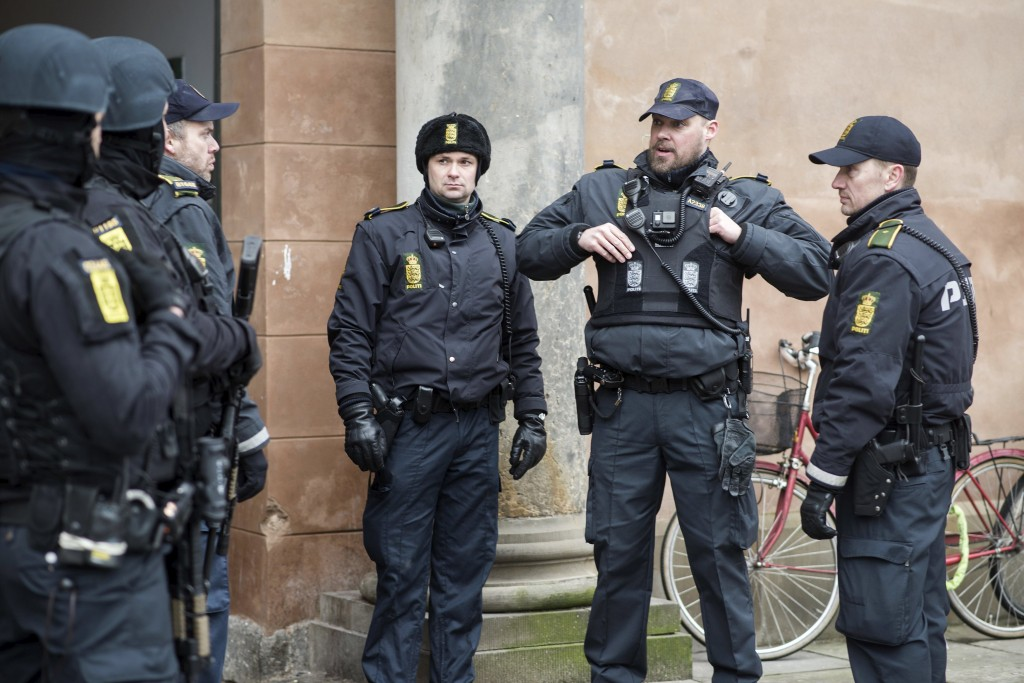 Danish police stand guard at the city court, during a trial of those arrested in connection with the February 2015 shooting attacks at a free speech event and a synagogue, in Copenhagen, Denmark, March 10, 2016. REUTERS/Emil Hougaard/Scanpix Denmark ATTENTION EDITORS - THIS IMAGE WAS PROVIDED BY A THIRD PARTY. FOR EDITORIAL USE ONLY. NOT FOR SALE FOR MARKETING OR ADVERTISING CAMPAIGNS. THIS PICTURE IS DISTRIBUTED EXACTLY AS RECEIVED BY REUTERS, AS A SERVICE TO CLIENTS. DENMARK OUT. NO COMMERCIAL OR EDITORIAL SALES IN DENMARK. NO COMMERCIAL SALES.