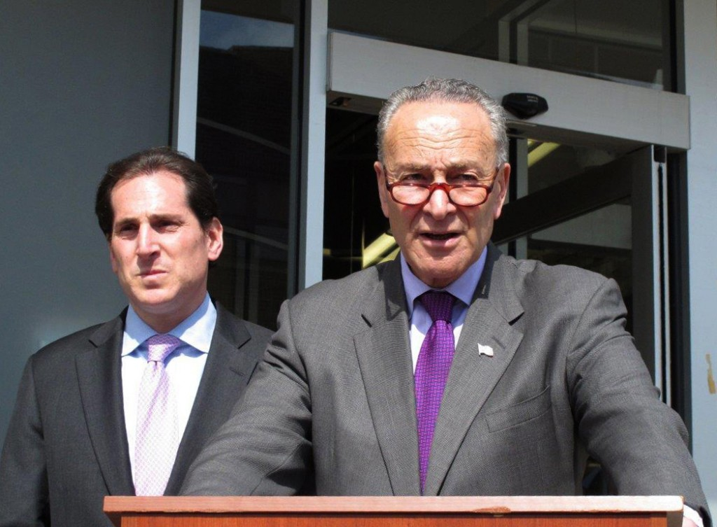 """FILE - In this March 11, 2016, file photo, Sen. Charles Schumer, D-N.Y., right, speaks at a campaign event in Lawrence, N.Y. The Justice Department is preparing to announce charges in a cyberattack on a small dam outside New York City, a case U.S. officials have linked to Iran. A person familiar with the matter says an announcement was expected March 24. Schumer said earlier this month that a Justice Department investigation had connected the breach to the Iranians. He called it a """"shot across our bow."""" (AP Photo/Frank Eltman, File)"""