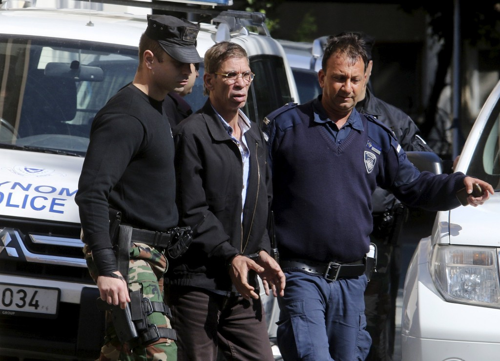 The man (C) who was arrested after he hijacked an EgyptAir flight, which was forced to land in Cyprus on Tuesday, is transferred by Cypriot police as they leave a court in the city of Larnaca, Cyprus March 30, 2016. REUTERS/Yiannis Kourtoglou