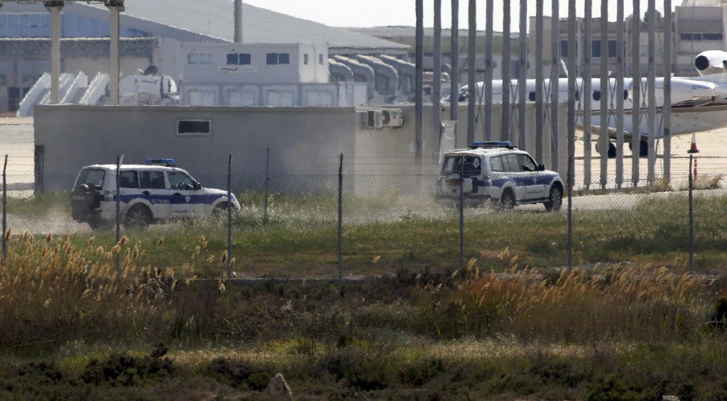 Police vehicles speed away after arresting the hijacker of an Egyptair Airbus A320 at Larnaca Airport in Larnaca, Cyprus, March 29, 2016 REUTERS/Yiannis Kourtoglou