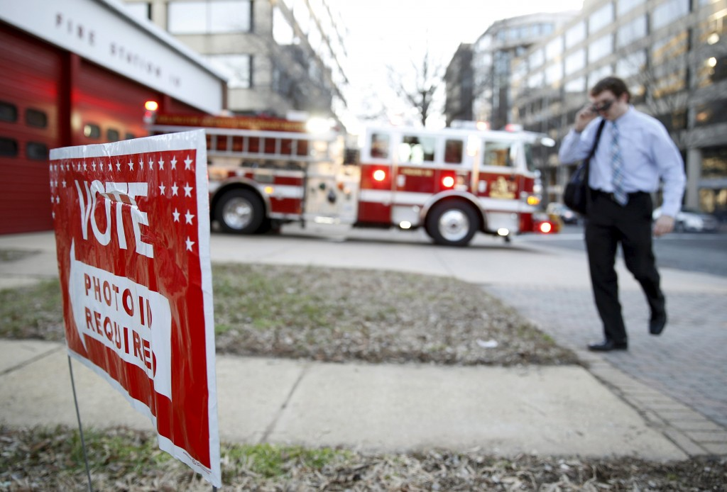 A man enters Fire Station 10 to vote in Super Tuesday elections in Arlington, Virginia March 1, 2016.    REUTERS/Gary Cameron