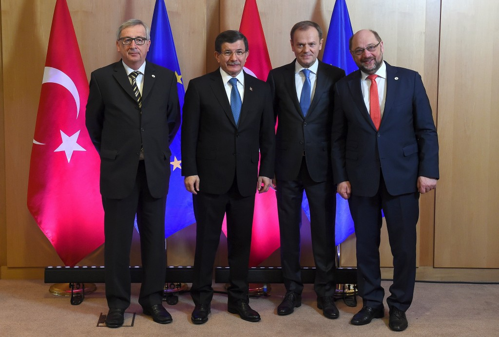 Turkish Prime Minister Ahmet Davutoglu poses with European Commission President Jean-Claude Juncker (L), European Council President Donald Tusk (2nd R) and European Parliament President Martin Schulz (R) during an EU-Turkey summit in Brussels, as the bloc is looking to Ankara to help it curb the influx of refugees and migrants flowing into Europe, March 7, 2016.   REUTERS/Emmanuel Dunand/Pool