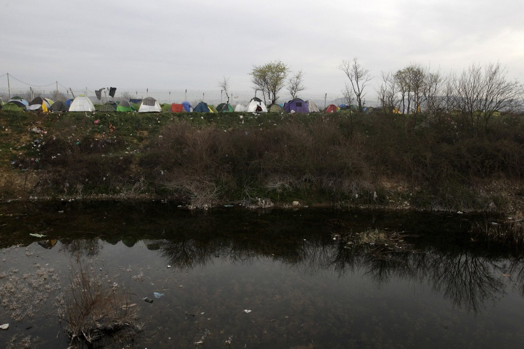 Tents of a makeshift camp for refugees and migrants are seen next to swamp waters next to the Greek-Macedonian border, near the village of Idomeni, Greece March 6, 2016. REUTERS/Alexandros Avramidis