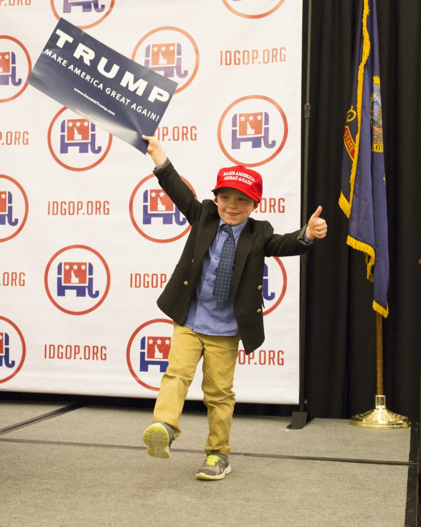 Five-year-old Axel Kiska climbs onto the stage with a Donald Trump hat and sign as the crowd waits for election results at the Idaho GOP Election Night Party in Boise, Idaho, on Tuesday. (AP Photo/Otto Kitsinger)
