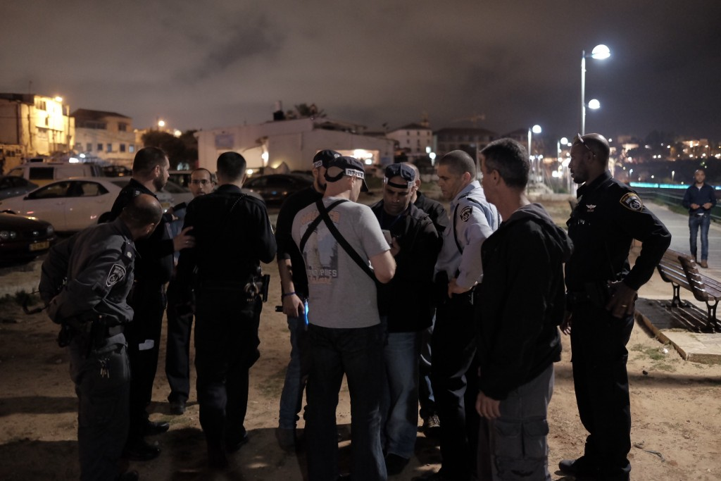 Israeli security and medical personnel at the scene of the stabbing attack at Jaffa Port, Tel Aviv, on Tuesday. (Tomer Neuberg/Flash90)